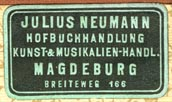 Julius Neumann, Hofbuchhandlung, Kunst-& Musikalien-handlung, Magdeburg, Germany (28mm x 16mm, early 20th c.)